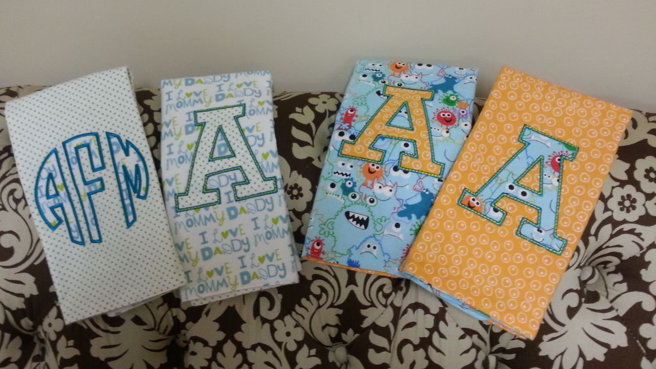 Applique on custom made burp cloths.  Ex Large Landon Font and Circle Font.