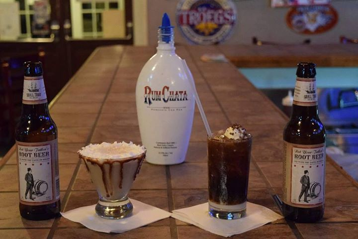 """""""The Smooth Creaminal"""" A full 1 ounce base of Rumchatta is layered by 4 ounces of Not Your Father's Root Beer, topped with a quarter ounce of Pinnacle Whipped vodka and finished with a dollop of vanilla bean ice cream."""