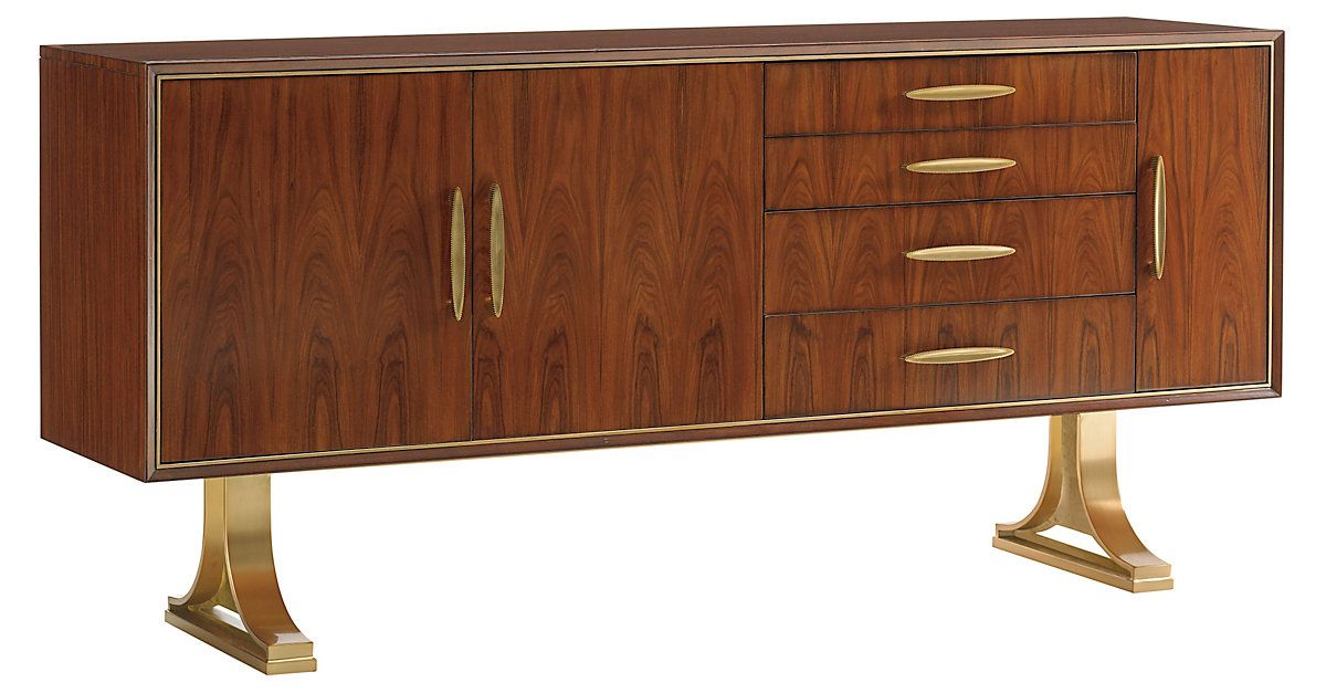 Raised on a gleaming brass-plated legs, this sideboard is masterfully crafted with warm, expressive rosewood-and-zebrano veneers and finished with a stylized zinc drawer pulls. A bevy of cabinets,...