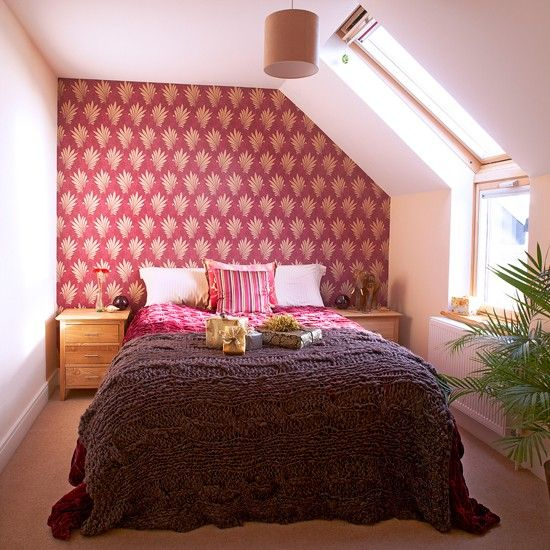 Red And White Bedroom With Patterned Wallpaper