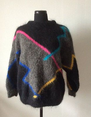 850340962b9442 Gorgeous vintage 1980s mohair sweater by Soft Options. Black and grey with  almost neon pink blue and yellow lines across the design. Great condition!