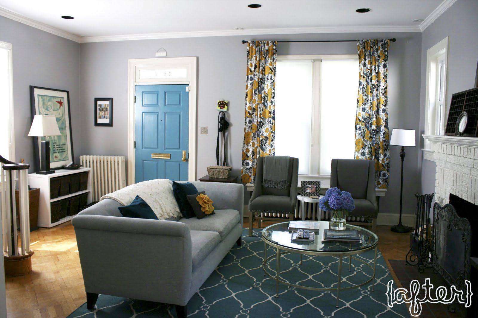 Gray teal gold living room with teal trellis rug gray furniture and white