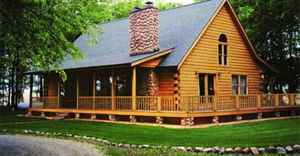 out of a movie! southern wrap around porch on this log home (the