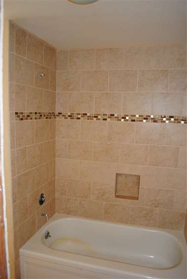 mosaic strip in the tub shower wall tile. Would have added ...