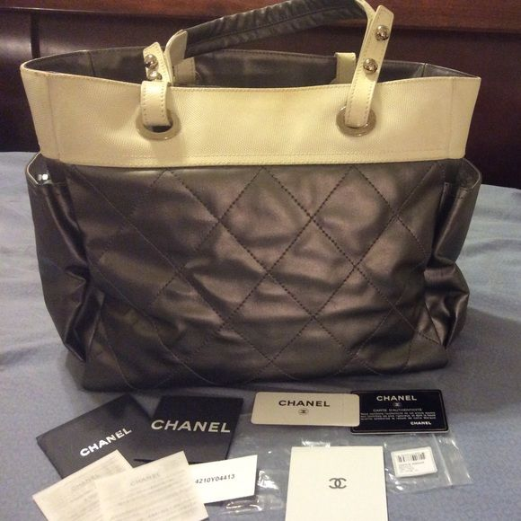 68def3b0cd3c Chanel Canvas Paris-Biarritz Tote This Chanel tote bag is a quilted gray  coated canvas with two exterior slip side pockets, and one exterior zip  pocket with ...