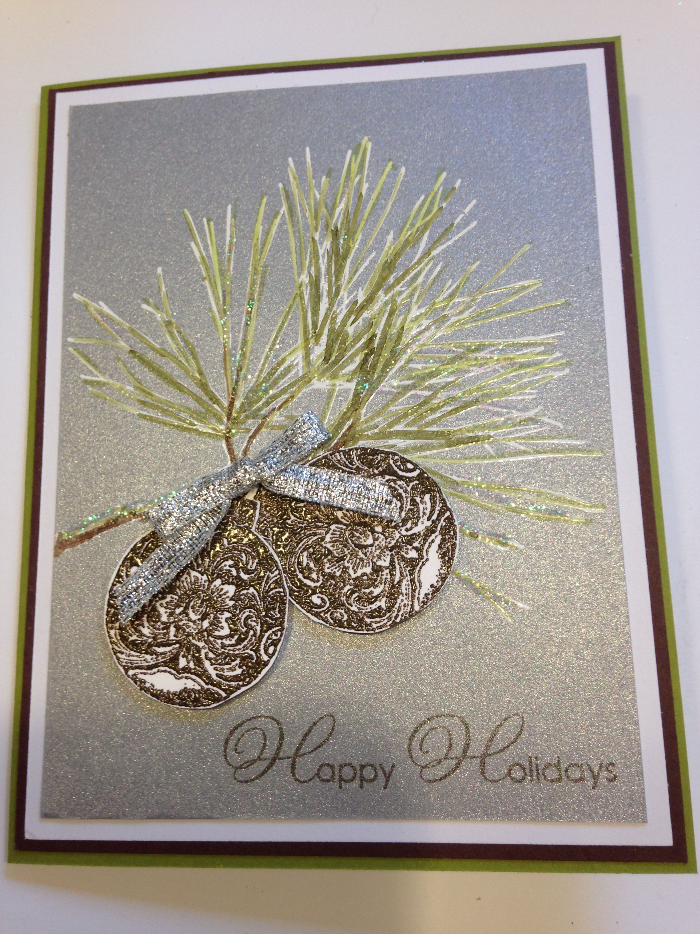 Ornamental Pine stamp set. White embossed and colored with blendabilities o  silver card stock