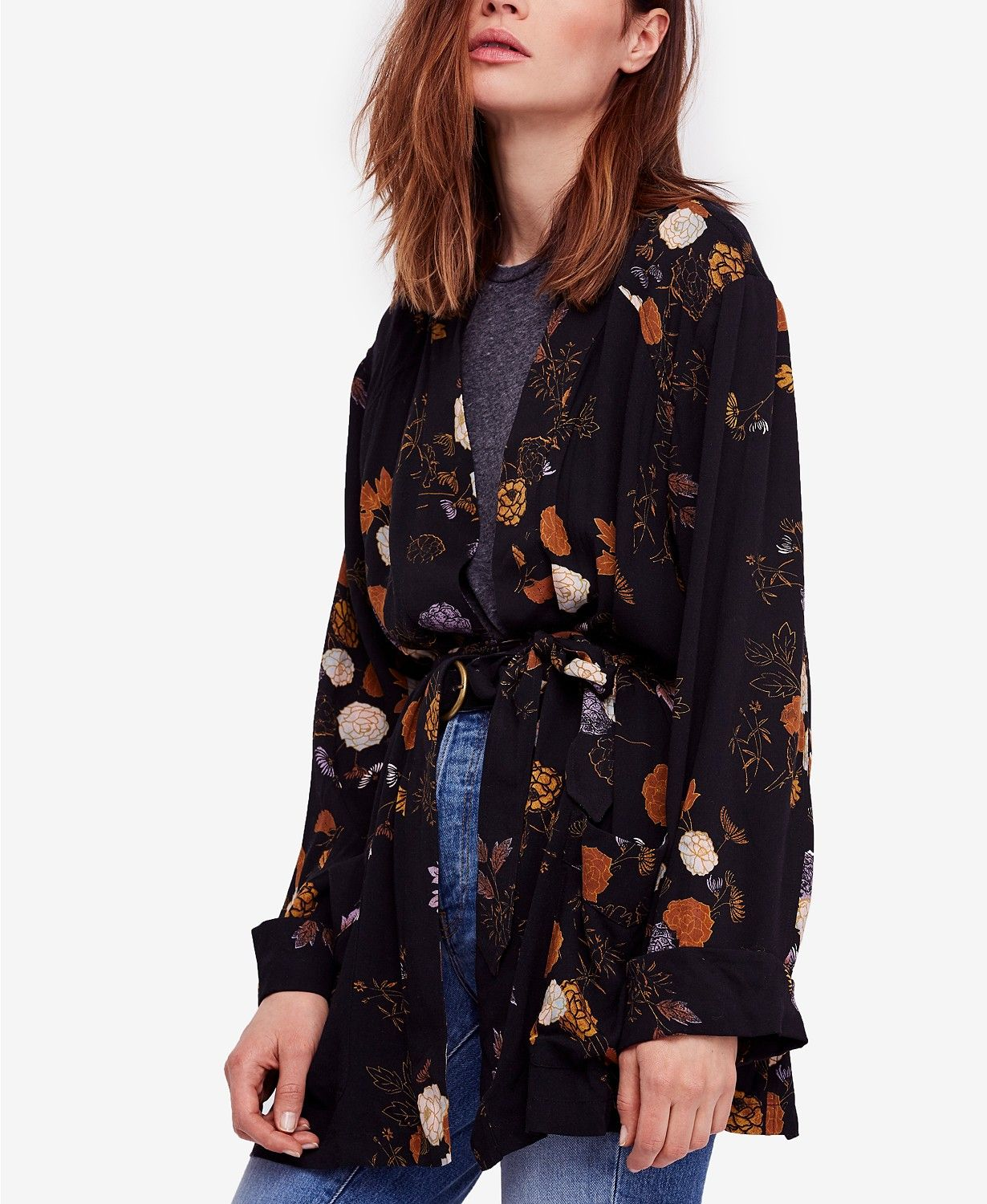 363be6493 Free People's kimono-inspired wrap jacket is styled with a pretty floral  print and a clever open front that ties-up with a self-tie belt.