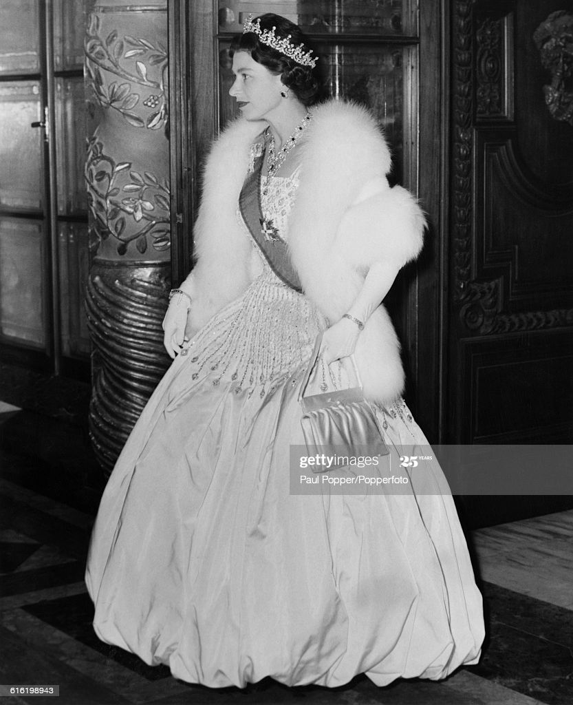 Queen Elizabeth II, wearing full evening gown along with