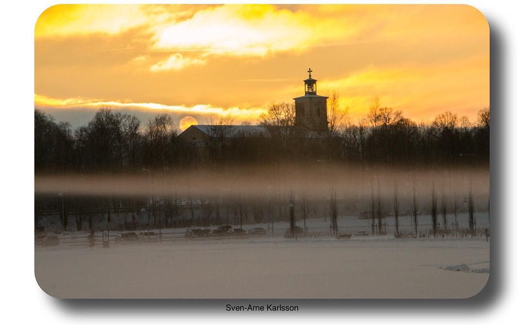 Sunset today. The church seen from Kumla Sjöpark