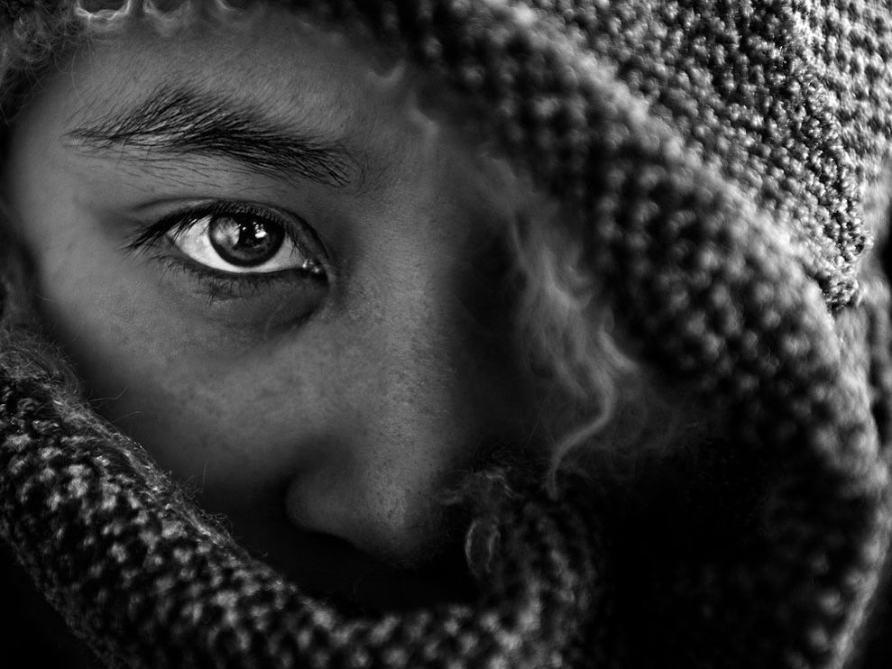 Hidden face. Photos like this really make me appreciate photography. A whole story can be written from one single shot. Beautiful.