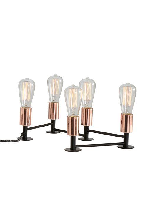 En bordslampa som består av 5 lampor som är sammanbundna med ...