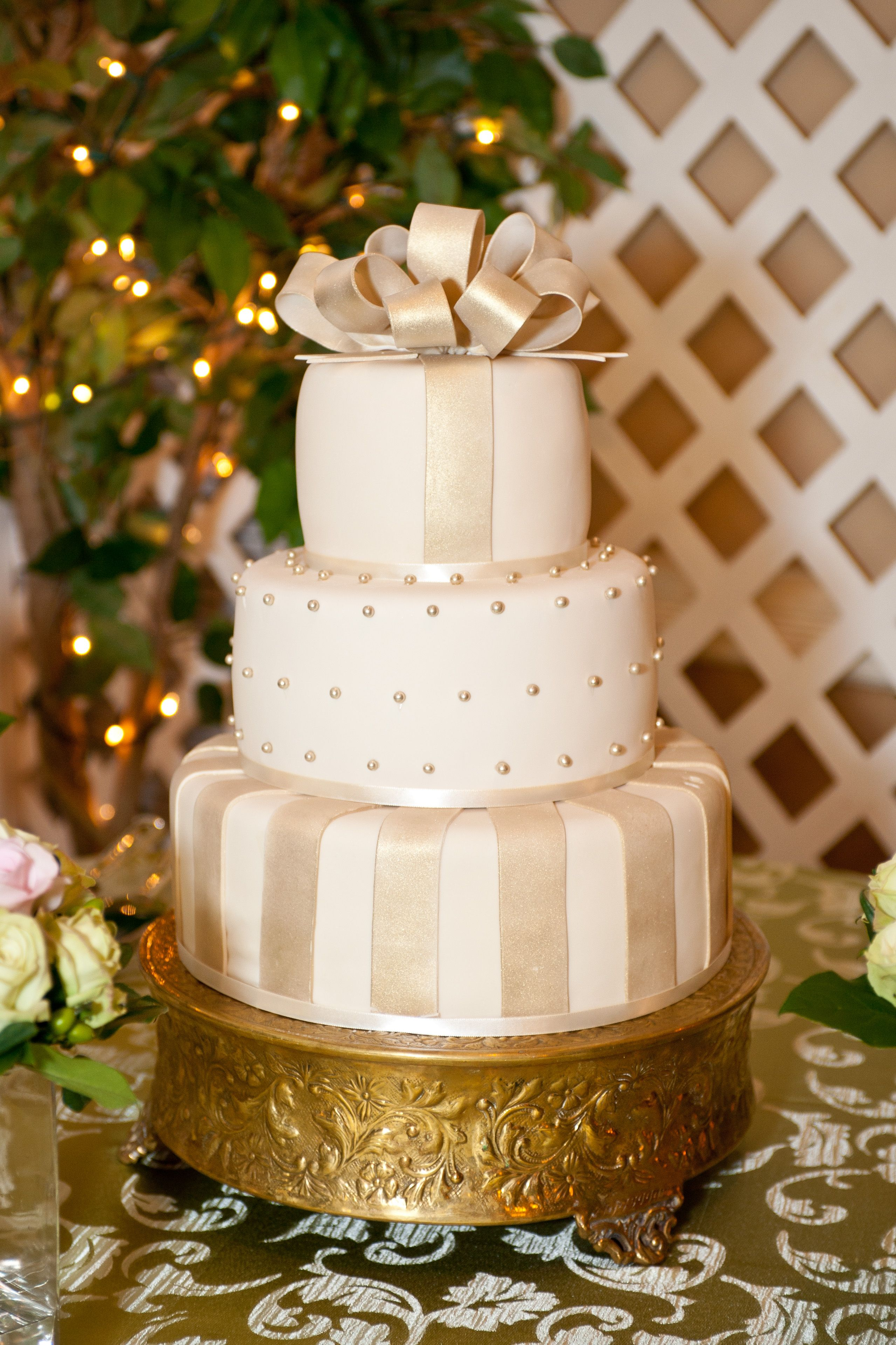 Gold And Cream Fondant 3 Tiered Round Cake With Decorations Bow Edible Pearls