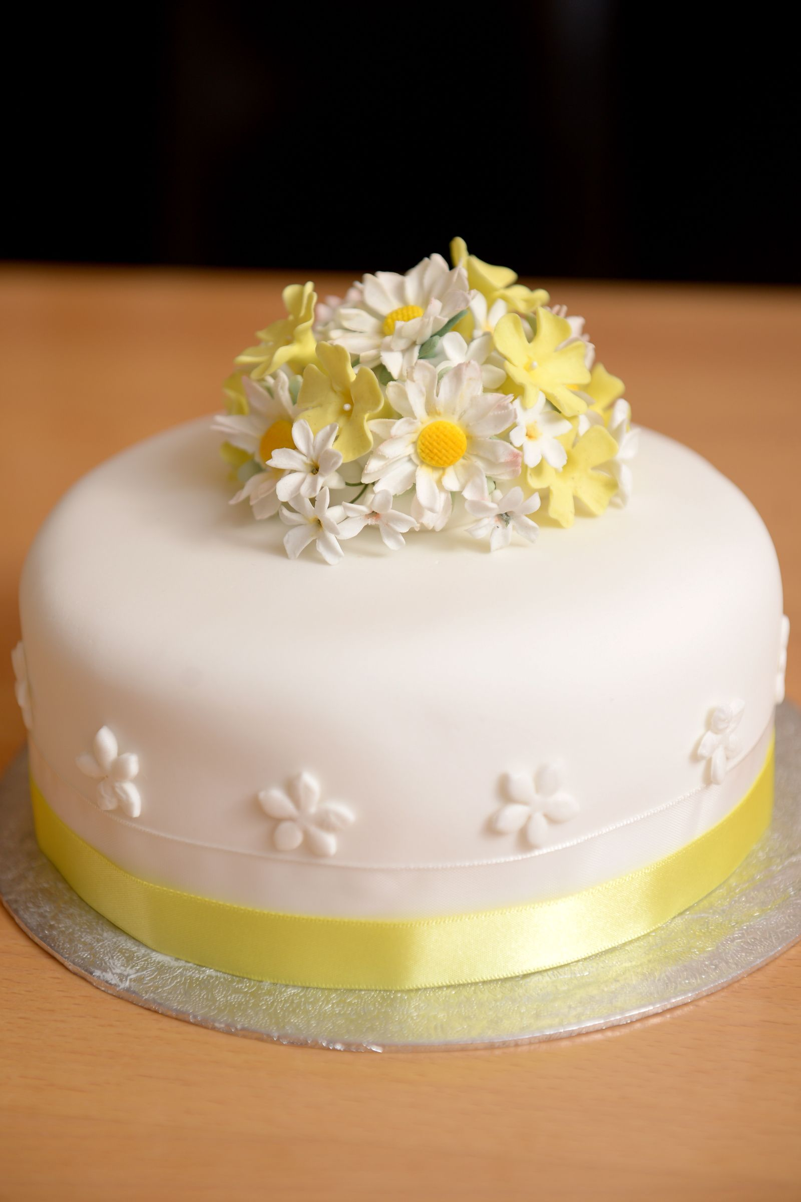 A Lemon Drizzle Cake Coated With Smooth Fondant Icing And