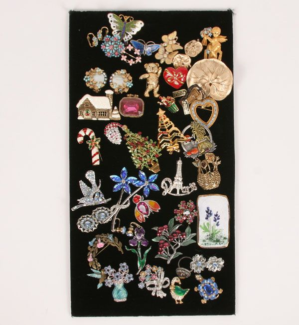 """Large lot of 42 pieces vintage costume jewelry; figural pins/brooches and earrings, including; Pell rhinestone bluebird, (1 7/8\""""W), Weiss flower and heart pin, Trifari water lily brooch and ER set, Robert Original enamel and jeweled Christmas tree, Napier articulated teddy, JJ, Avon, Barclay enamel flowers. Along with 3 vintage retail tags. One or two pieces missing stones.  Overall very good condition. This lot is to be considered as-is."""