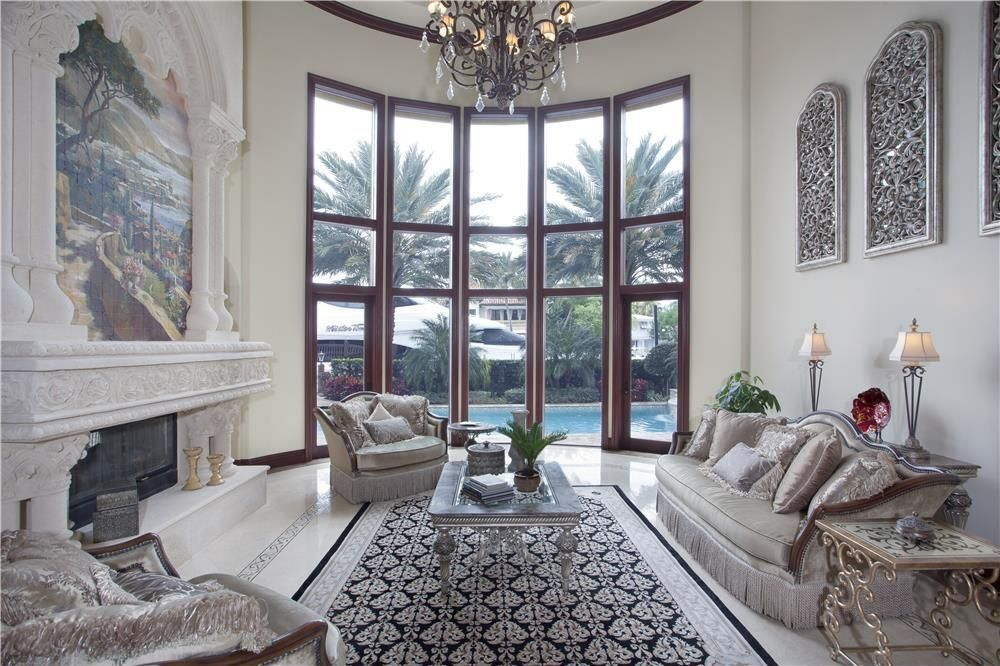 Elegant Living Room In Mediterranean Style With French Doors And A White Marble Floor