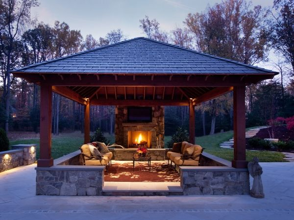 This Outdoor Family Room Includes A Fireplace And Enclosed Seating Area Enclosed Patio Gazebo Backyard Gazebo