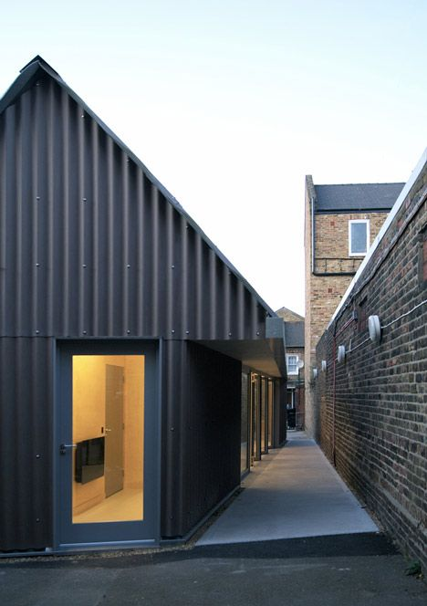 School Gatehouse Built On A Strict Budget Charcoal Corrugated Roof Sheeting Used As Cladding Vertically Installe House Cladding Building Design Architecture