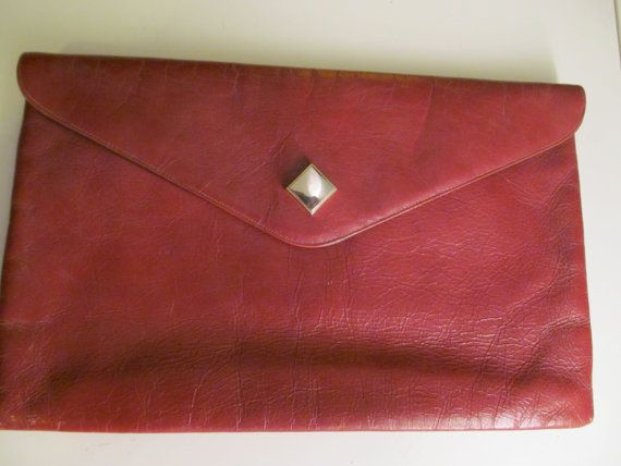 Vintage Brown Leather Signed Susan Gail Envelope Clutch. $16.00, via Etsy.