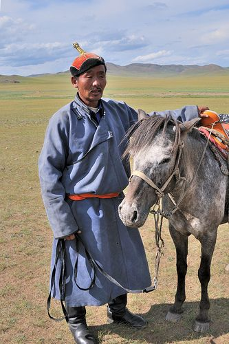 Mongolian man with his horse