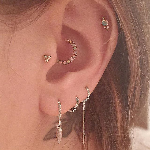 conch, tragus, and helix with opal jewelry