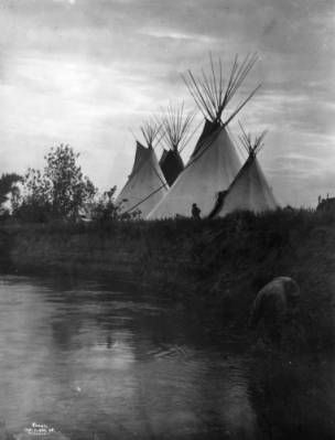 1908 setting sun on the bank of the Little Bighorn River in Montana.