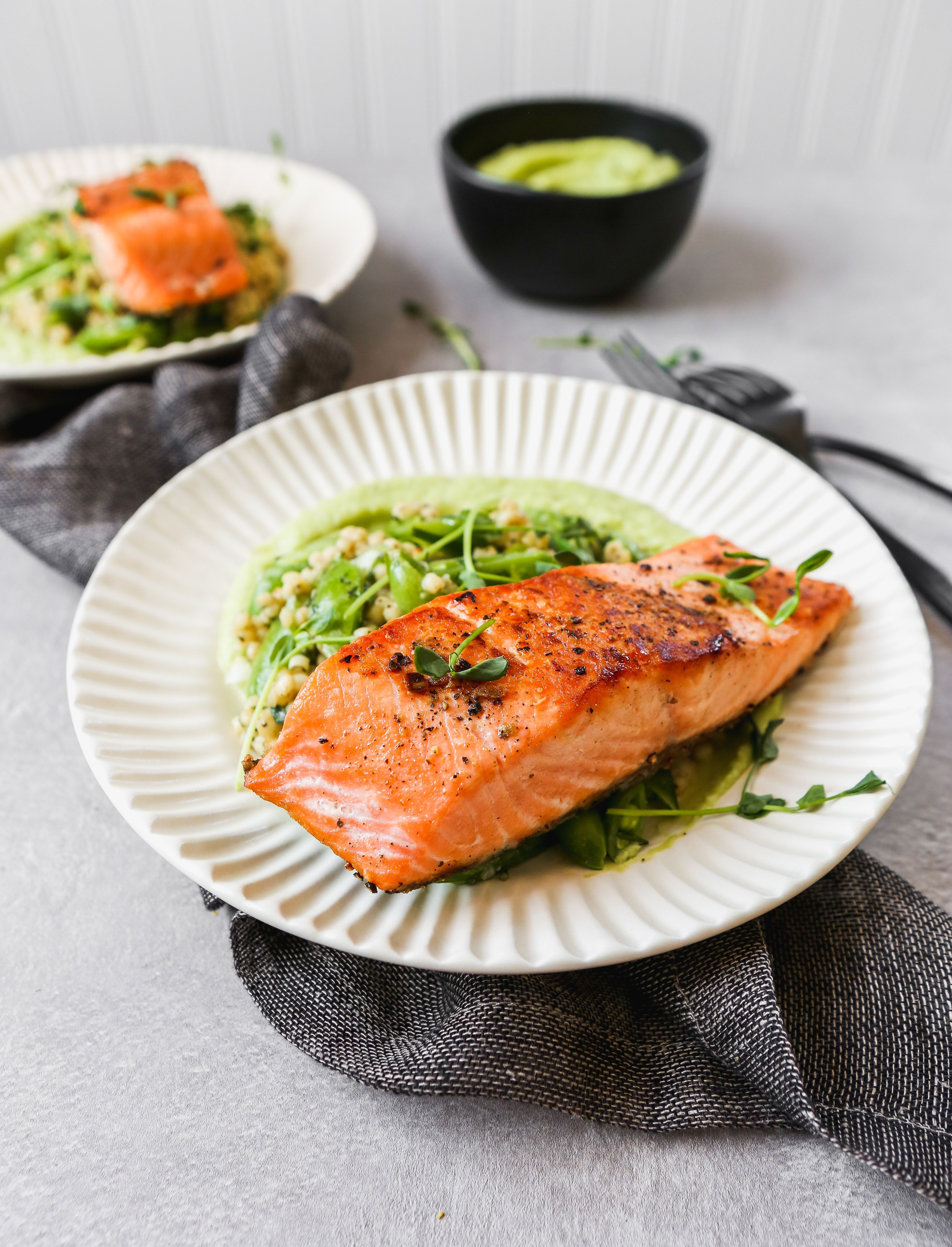 Pan Seared Salmon with Leek Purée and Sorghum Pilaf #searedsalmonrecipes Make the perfect seared salmon with this simple, yet surprising, recipe. Then serve it with a flavorful leek purée and a healthful sorghum pilaf for a fresh, healthy dinner. #salmon #healthy #glutenfree #dinner #searedsalmonrecipes