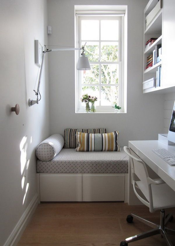 Modern Small Home Office With White Furniture And Sofa Stripe Cushions.