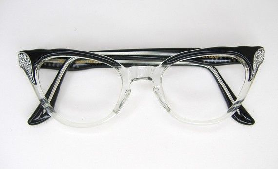 Very beautiful pair of ladies black clear fades eyeglasses or sunglasses frames with clear rhinestones. Frame France. They are in excellent vintage condition. (NOS). New Old Stock. Never worn. Five barrel hinges. They have no lens in. Ready to have the lens or your choice put in. Please ask any questions. Check out my shop for more unique vintage eyewear. http://www.etsy.com/shop/Vintage50sEyewear      Lens size - 44mm  Bridge size -20mm  Temple Length-5 1/2  Across Front- 5 1/4  Lens Brow…