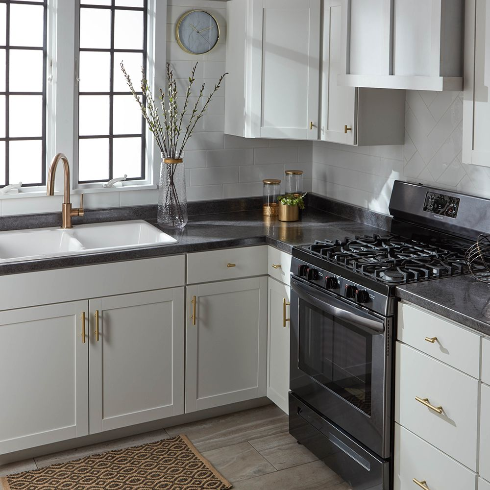 Black And White Kitchen Featuring Stunning Gold Accents Get This Look Today W Black Kitchen Countertops Kitchen Black Counter White Cabinets Black Countertops