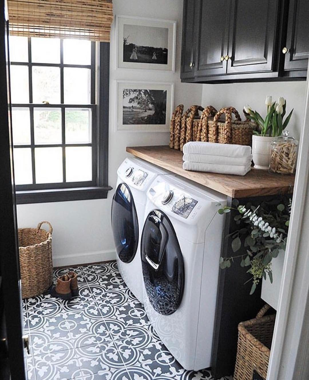 Farmhouse Laundry Room With Black And White Patterned Tile