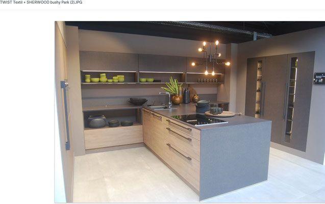 cuisine en bois et rev tement type textile focus sur l 39 ilot pur e contemporaine collection et. Black Bedroom Furniture Sets. Home Design Ideas