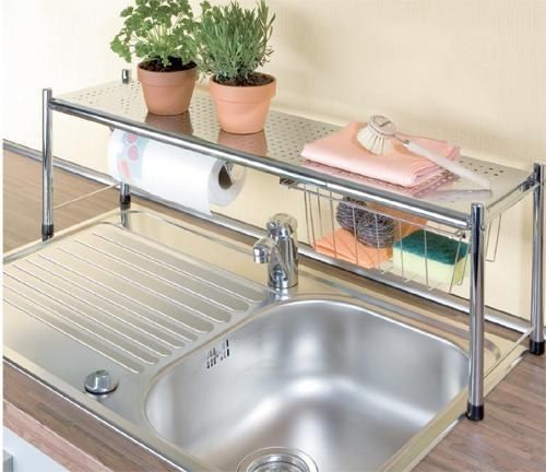 Get an over the sink shelf to double up on counter space for Tiny apartment storage ideas