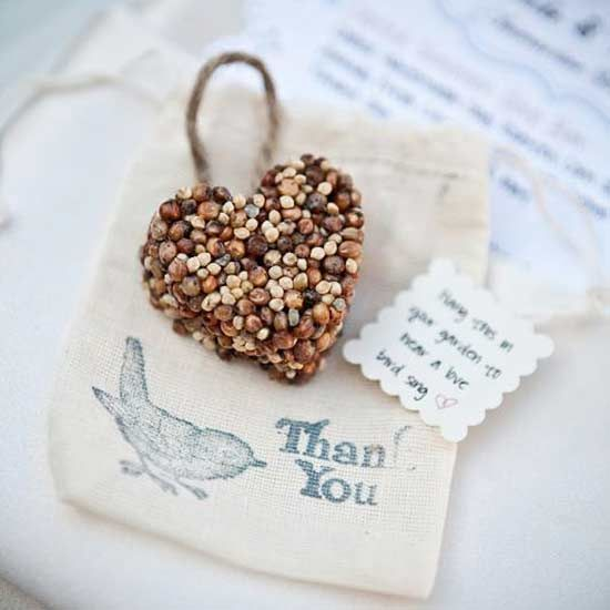 Use cupcake molds to make these heart-shaped birdseed hangers. Every time a flock of birds comes to visit the backyard, guests will think of you and your creative party favor prowess. via Polka Dot Bride/