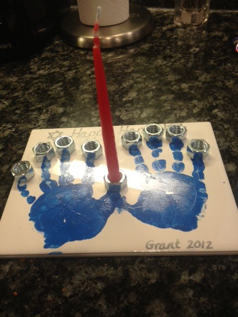 Handprint Menorah for Hanukkah Use tile from Lowe's, acrylic paint, bake in oven at 350 for about 30 min, attach nuts with glue that can withstand flames.
