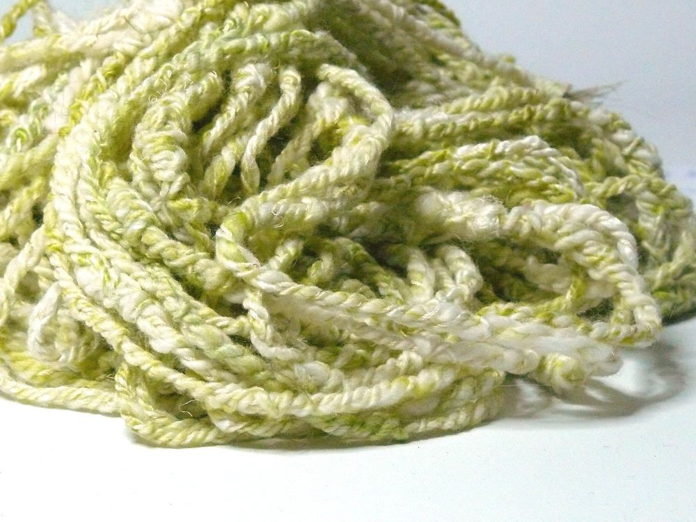 Boho Chick - available on Etsy (MelSpunYarn) - This is one of my fun handspun art yarns.  She insists on being unique. You be the judge...  Even though it is an art yarn, this yarn is well suited to being knit or crocheted. Simply combine it with some hanks of store-bought yarn in similar yarn diameter and a solid color to create a stunning piece of art. 70g - 36m - next to skin soft (not super soft, though!) - very textured - will felt ...
