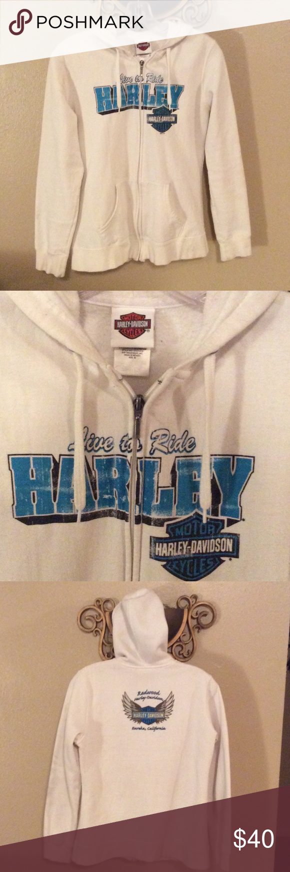 Harley Davidson White Hoodie Harley Davidson, Eureka, CA white. Hooded sweatshirt. Has very few minor discolorations and some pilling in the underarms . Gently used & very comfy, I'm sad to see it go. Harley-Davidson Jackets & Coats