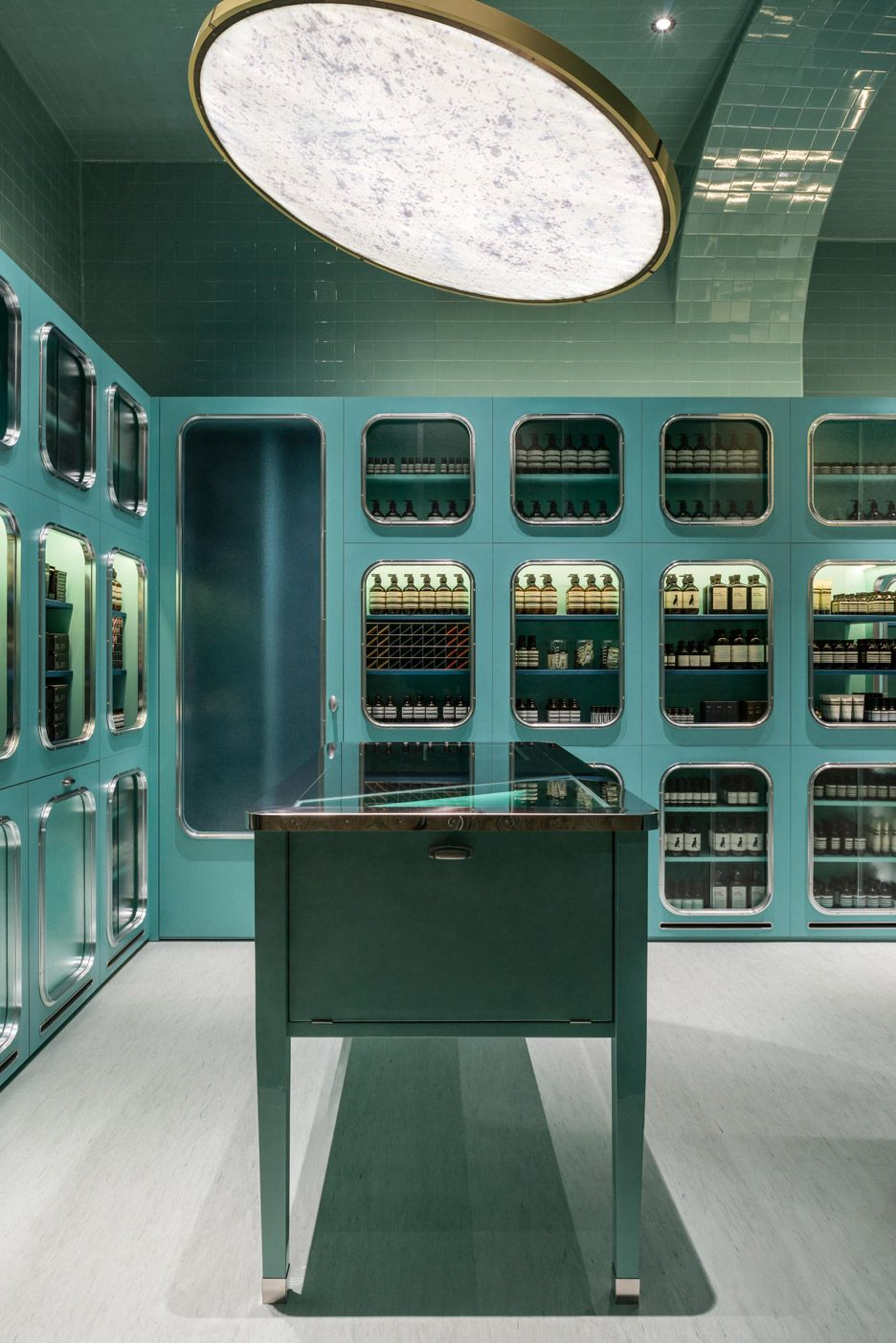 dimorestudio designs glossy teal interior for aesop store