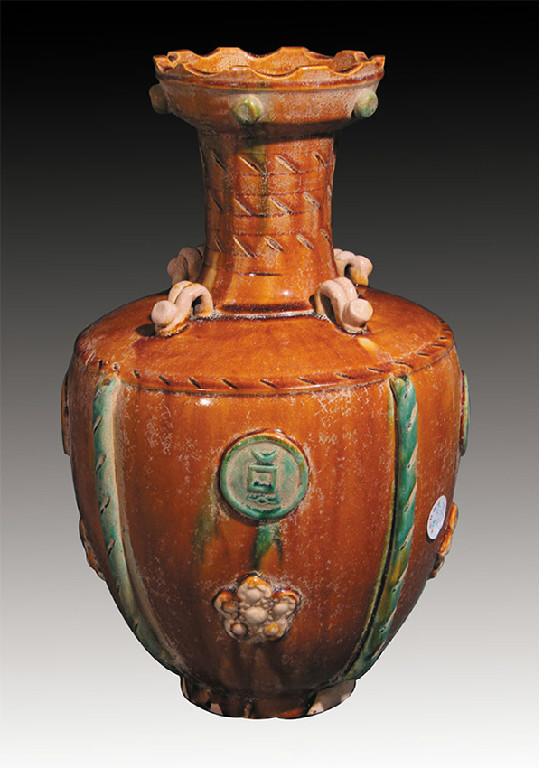 A RARE AND FINELY CARVED PORCELAIN BOTTLE, TANG SAN CAI- Tang Dynasty  D7.5inxH15.7in