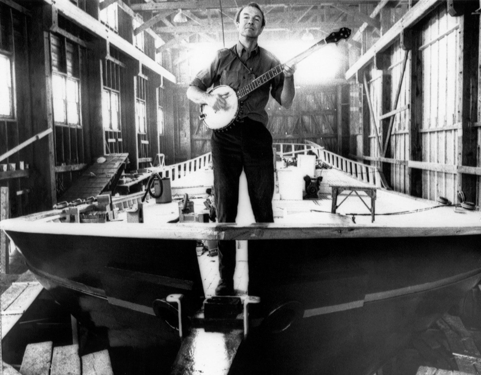 Pete Seeger, strumming a banjo on the bow of the Clearwater sloop.  He and a group of volunteers raised $150,000 to build the vessel and used it to dramatize the fight against pollution in the Hudson River Valley. He and his wife were instrumental in saving the Hudson, which industry had polluted to the point where we, as children, were not allowed to even touch the water. I remember walking along the shore, often finding the bones of unfortunate creatures who drank from the water.