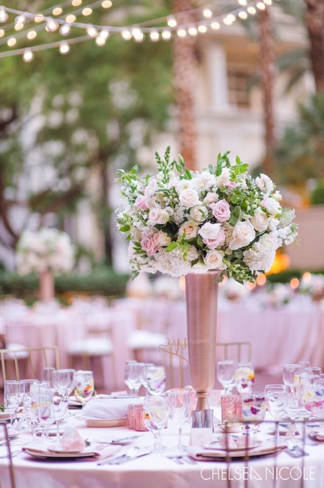 Tall large centerpiece of greenery with white