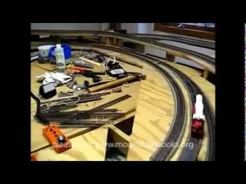 HO Scale Model Train Layout - This video came from one of my customers named Steve Knudsen. He is a beginner that is helping his friend get his trains set up and running after the project was halted due to a stroke that his friend suffered. He has completed the base, hills and laid a lot of track.