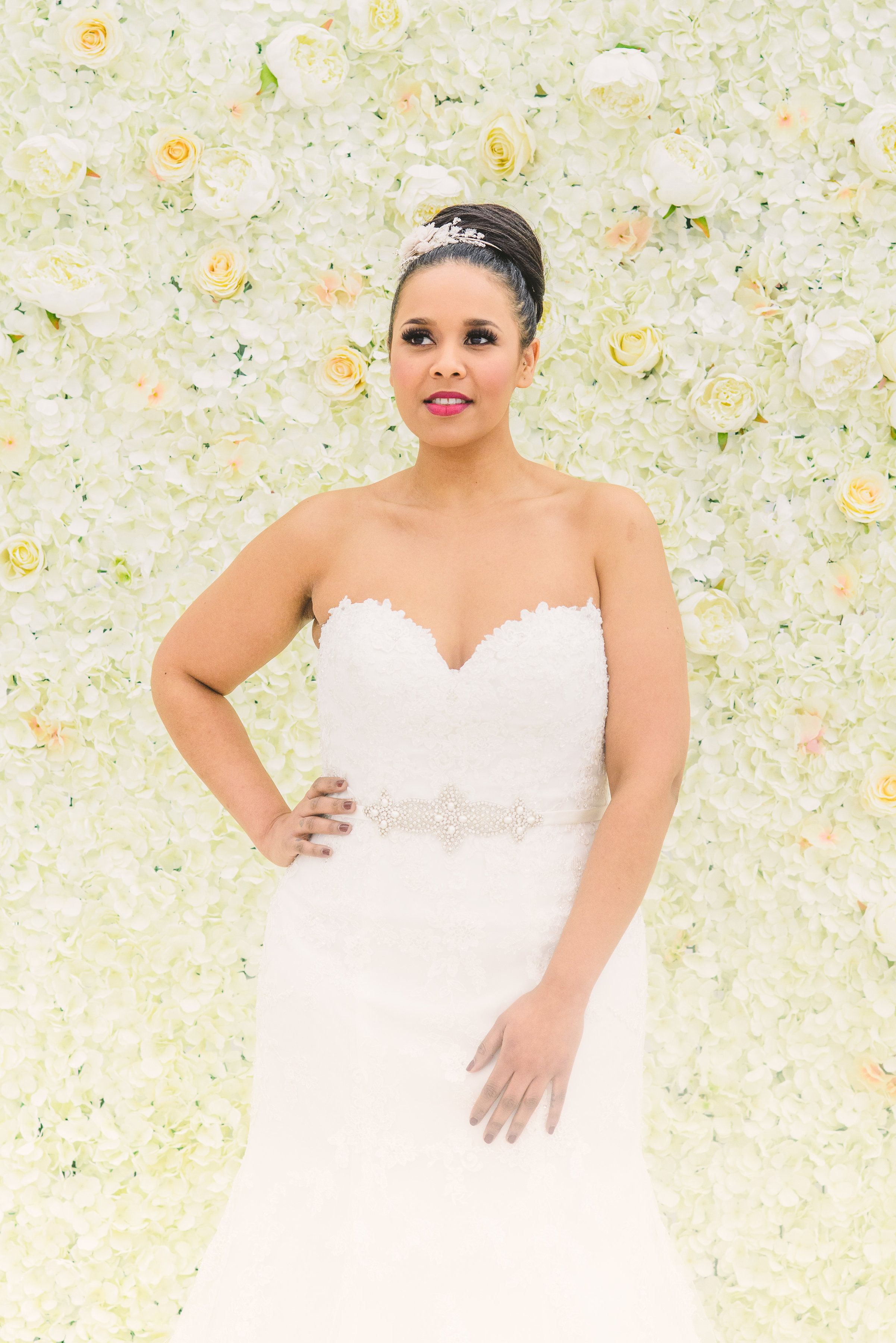 Kasi wears \'Lili\' by by Ronald Joyce. Flower Wall by Qube Events ...
