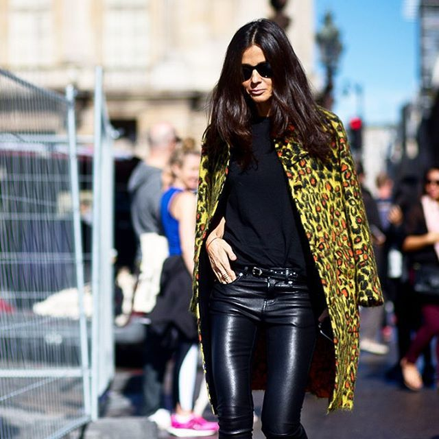 Animal print retains its wild side at #PFW with specks of orange highlighting the classic motif. #streetstyle by #theurbanspotter