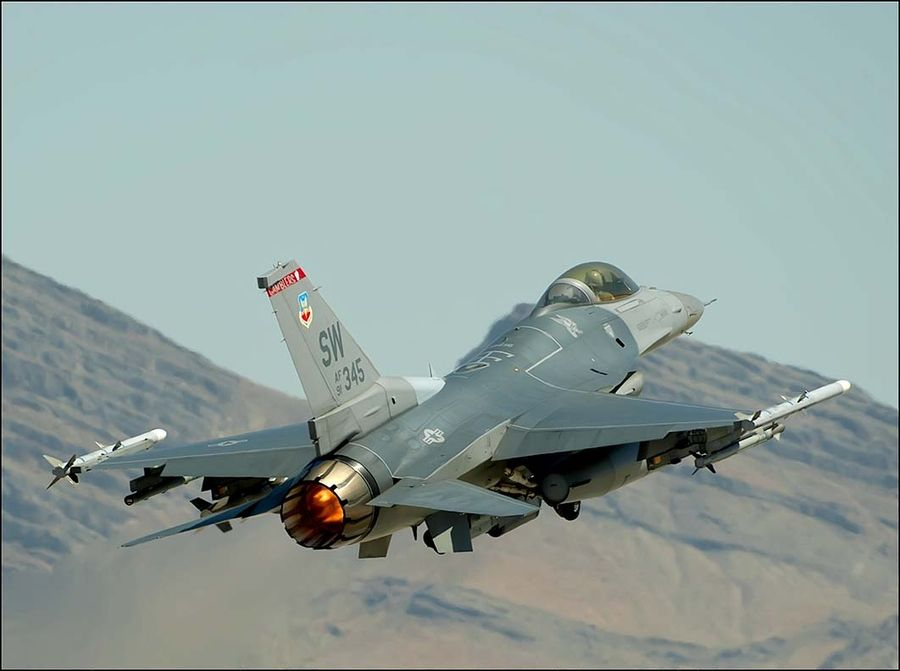 F-16 on afterburner by Richard Small