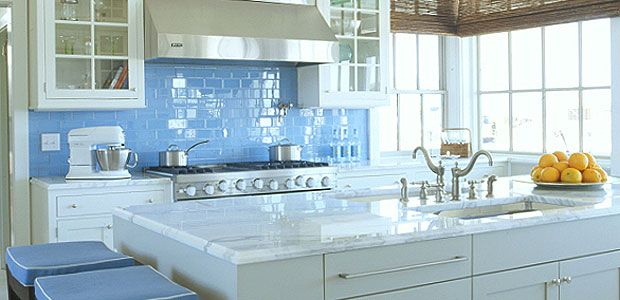 I don't love the color but I really like the shiny subway tiles and the white and gray marble countertops