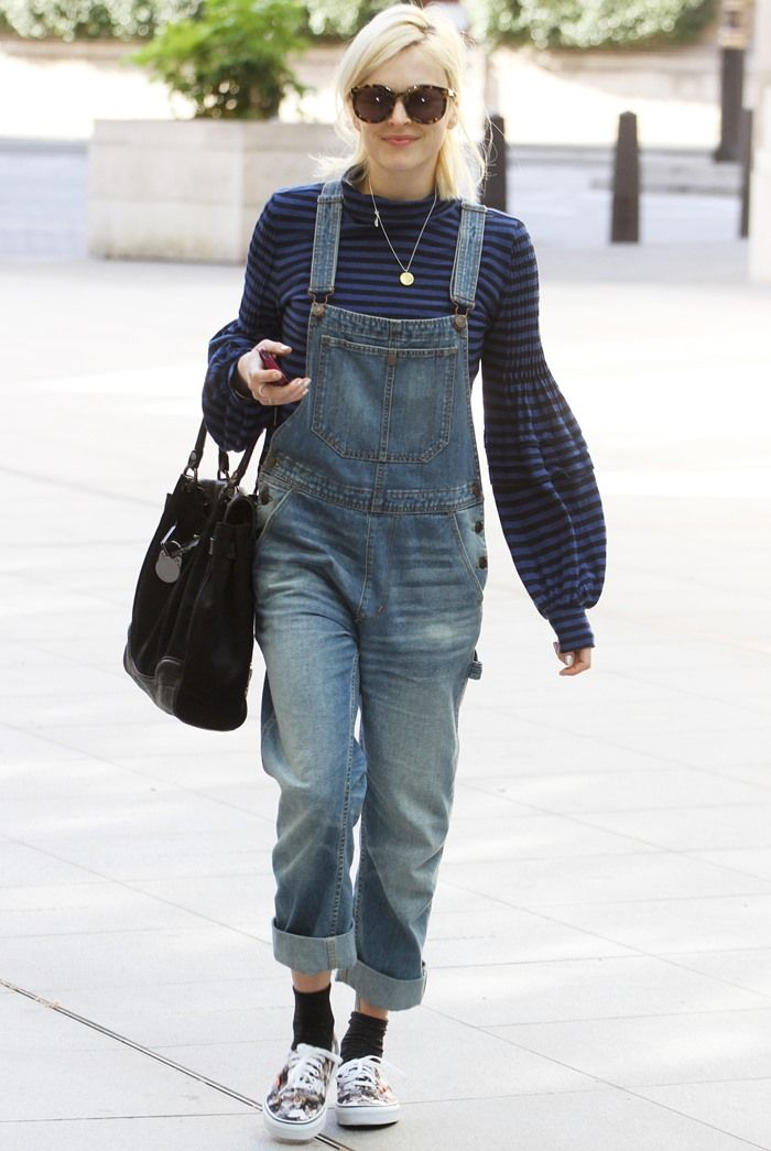 Fearne Cotton wearing her blue denim dungarees with printed sneakers and black socks while heading to work at the BBC Radio 1 studios in London, England, on April 18, 2014