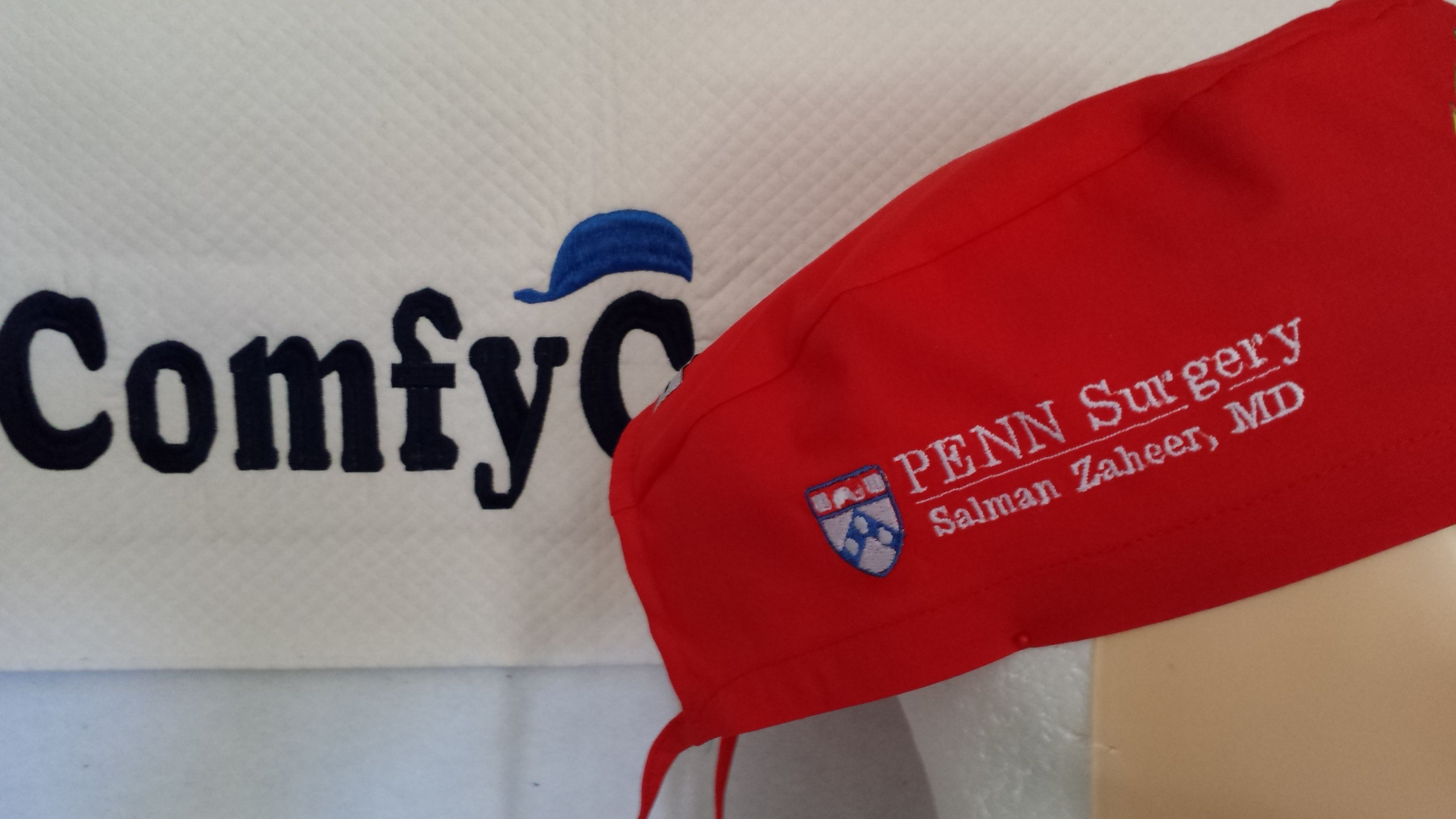 Custom embroidered male scrub cap with University of Pennsylvania Surgery