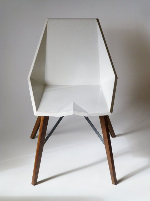 A hand cast concrete and wood chair made in washington for Inneneinrichtung design studium