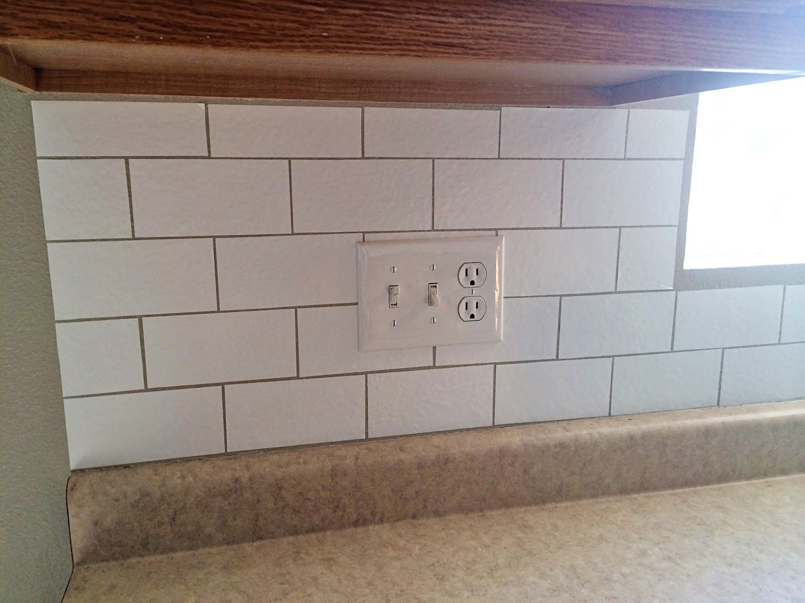 Create a custom backsplash with contact paper. The best part is its ...