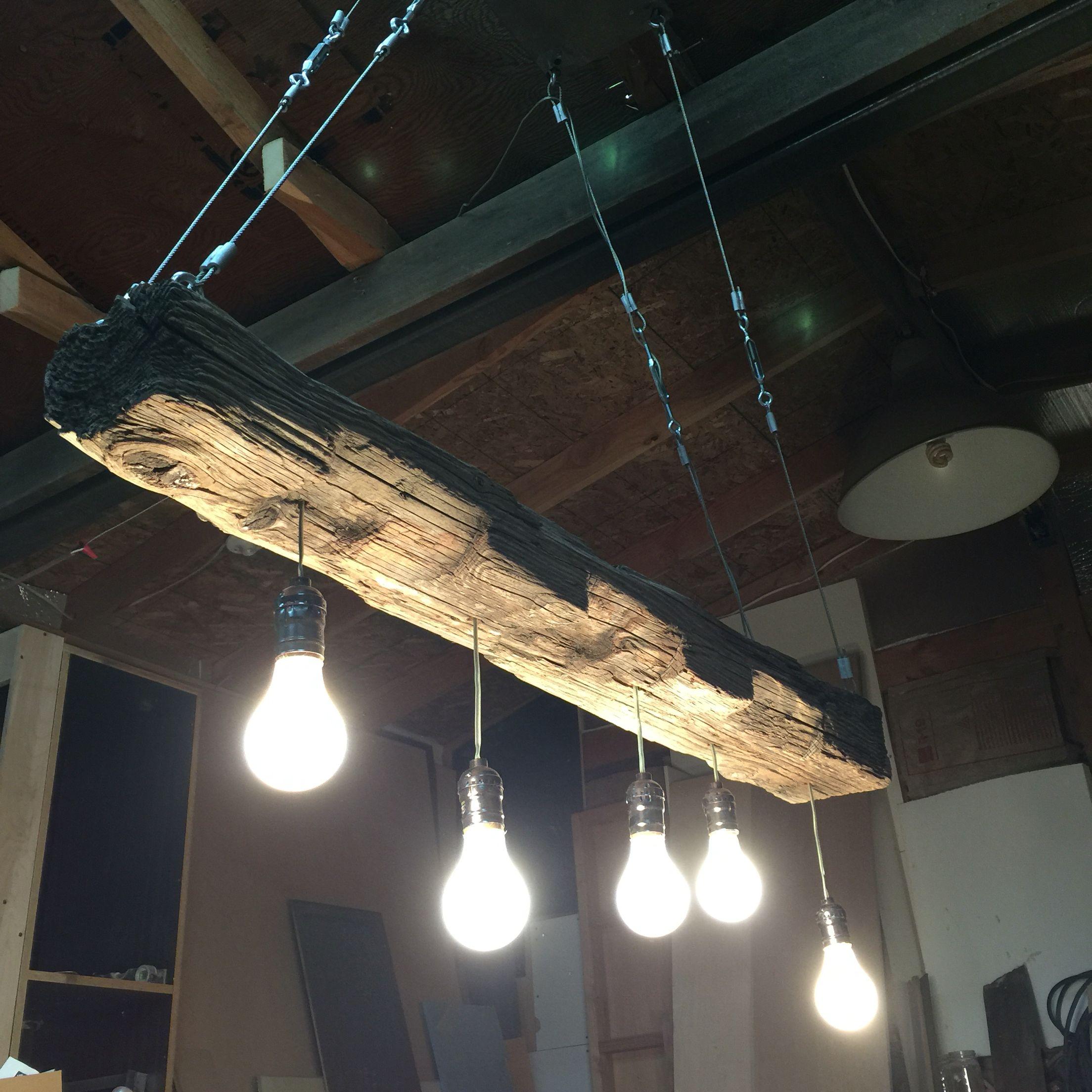 Reclaimed wood beam chandelier. Barnwood rustic industrial furniture  www.curtisfrankdesign.com
